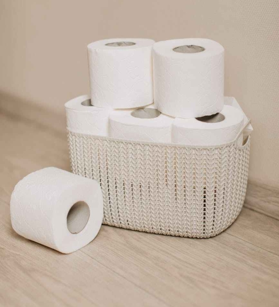white tissue paper roll on white wicker basket